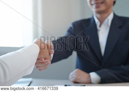 Business Man And Job Seekers Shake Hands After Agreeing To Accept A Job And Approve It As An Employe
