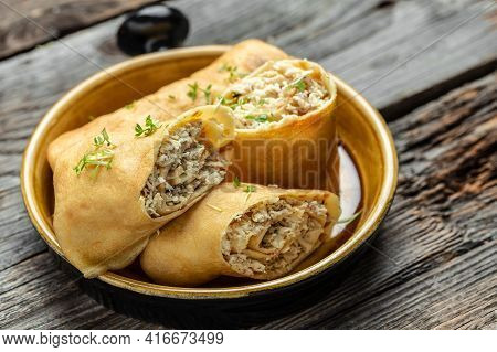 Savory Crepe Rolls With Ground Chicken Meat. Pancakes With Chicken On A Wooden Table, Long Banner Fo