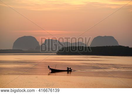 Beautiful View In The Morning During Sunrise And Fisherman Longtail Boats
