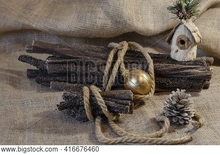 Festive Composition With Dog Treats On Sacking. A Dried Cow's Stomach Is Tied With A Rope. Beef Trip