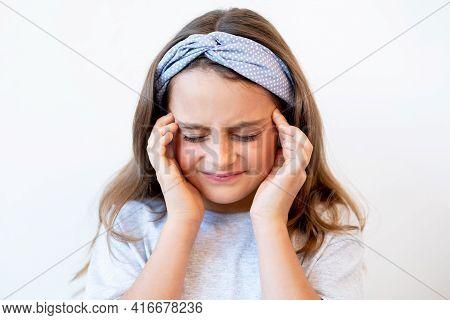 Kid Migraine. Tension Headache. Stress Anxiety. Portrait Of Disturbed Tired Suffering Little Girl Ex