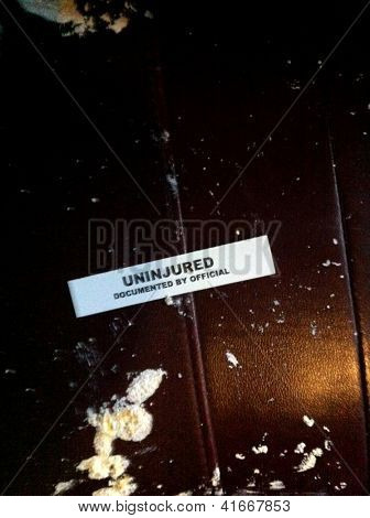 LITTLE FALLS, NJ - JAN 30: A label with the words 'Uninjured' is shown in a NJ Transit train to NY on January 30, 2013 in Little Falls, NJ. The train collided with a truck carrying paint material.
