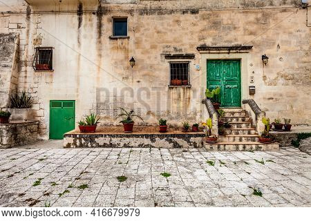 Matera, Italy. July 25, 2015. Old Mansion In The Town Of Matera In Italy. Facade Of An Ancient Palac