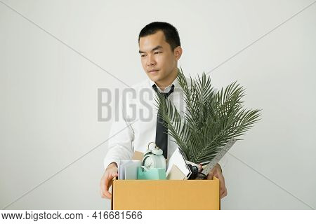 Asia Businessman Is Upset By Dismissal In Packing Belongings Company Into Cardboard Box Young Man St