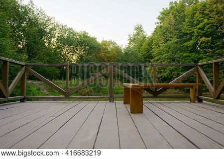 A Small Observation Deck Made Of Wood In The Middle Of The Forest On A Summer Evening