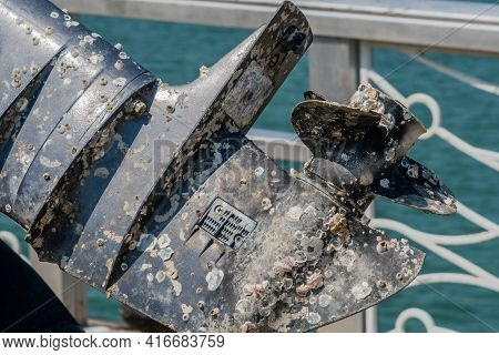 Closeup Of Marine Outboard Engine Covered With Barnacles.