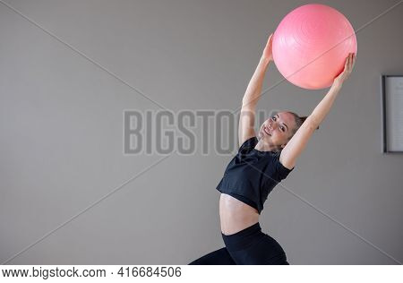 Beautiful Woman Training Pilates On A Fitness Ball In Gym, Women At Exercise With Fitness Ball