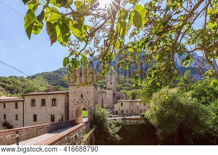 Beautiful View Of Roman Catholic Abbey (san Vittore Alle Chiuse) From The Medieval Bridge. Genga, Ma