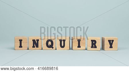The Word Inquiry Made From Wooden Cubes On Blue Background. Conceptual Photo