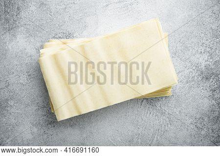 Organic Lasagna Pasta Sheets Set, On Gray Stone Background, Top View, Flat Lay