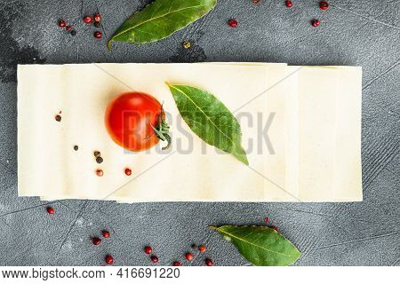 Lasagna Dough Sheets Set, With Seasoning And Herb, On Gray Stone Background, Top View, Flat Lay