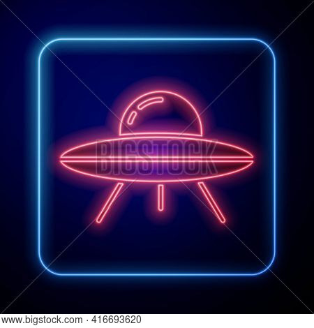 Glowing Neon Ufo Flying Spaceship Icon Isolated On Blue Background. Flying Saucer. Alien Space Ship.