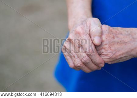 Close-up Of Elderly Woman's Hands Joined Together. Focus On Hands Wrinkled Skin. Space For Text. Hea
