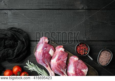 Raw Duck Legs. Poultry Meat Ready To Cook Set, With Herbs And Ingredients, On Black Wooden Table Bac