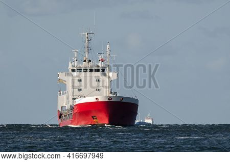 Merchant Vessel - Red Ship On A Cruise At Sea