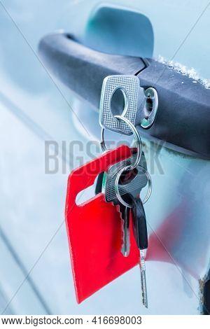 Forgotten Keys Inserted Into Car Door Lock