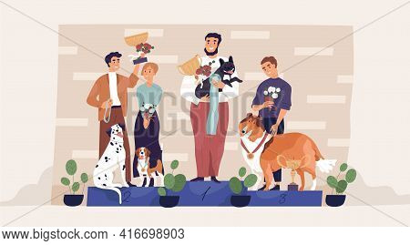 Winners Of Dog Contest Standing On Pedestal With Their Owners, Holding Golden Cups And Medals. Champ
