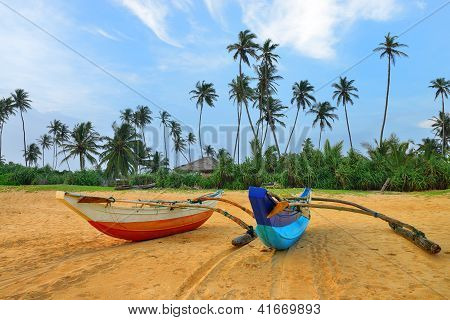 Fishing Boats On A Tropical Beach