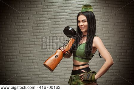 A Woman In A Sexy Military Uniform With A World War Ii Ppsh-41 Submachine Gun Is Dressed In A Short