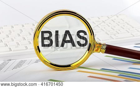 Magnifying Glass With The Word Bias On The Chart Background