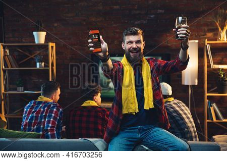 Group Of Friends Watching Tv, Sport Match Together. Emotional Man Cheering For Favourite Team, Celeb
