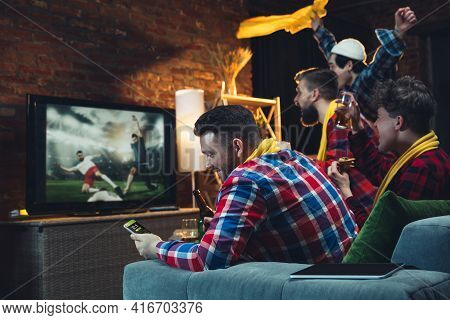 Group Of Friends Watching Tv, Sport Match Together. Emotional Fans Cheering For Favourite Team, Watc
