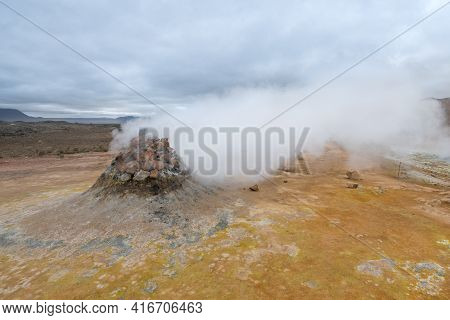 Steam Rising From Boling Mud In The Icelandic Landscape In Namafjall Area. Misty, Cloudy Day.