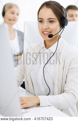 Call Center. Group Of Diverse Operators At Work. Beautiful Woman In Headset Communicating With Custo