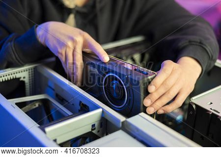 Close-up Of Gamer Girl Installing New Gpu Video Card In Her Gaming Pc