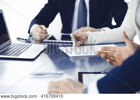 Business People Discussing Contract Working Together At Meeting In Modern Office. Unknown Businessma