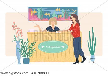 Woman Is Talking To The Receptionist At The Reception. Reception With An Aquarium. Check In At A Hot