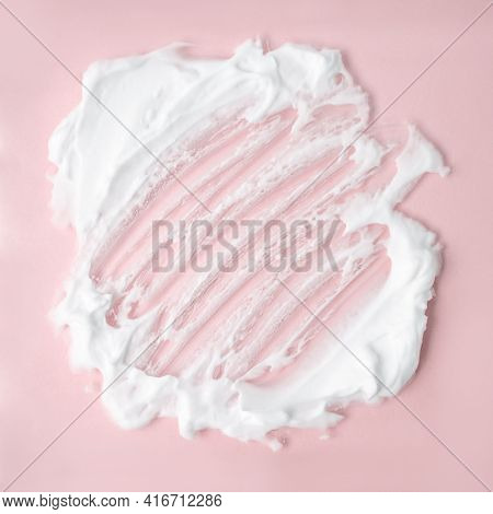 White Cosmetic Foam Texture On Pink On Pink Background. Cosmetic Mousse, Cleanser, Shaving Foam, Sha