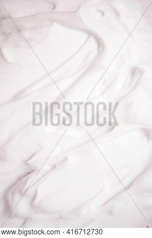 White Cosmetic Foam Texture Background. Cosmetic Mousse, Cleanser, Shaving Foam, Shampoo. Foamy Skin