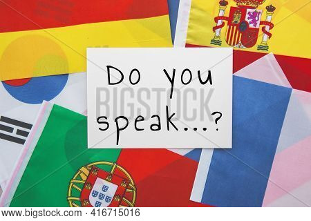 National Flags Of France, Porutgalia, Spain, Japan And Others And The Inscription Do You Speak, Educ