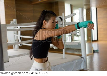 Asian Woman Kick Boxer Ready Punching For Exercise At Gym