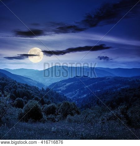 Countryside Landscape In Summer At Night. Beautiful Nature Scenery With Meadows On The Hills Rolling