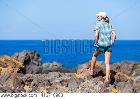 Young Woman Enjoying Summer Vacation Near Ocean
