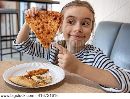 Funny Little Girl Eating Cheese Pizza For Lunch Close Up.