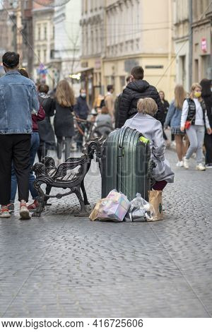 Full Street Trash Can In The Center Of The Year On The Pedestrian Zone, Selective Focus. Concept: Ec