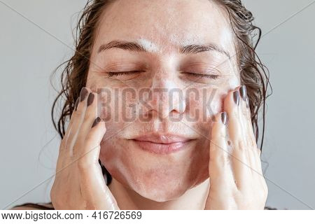 Close Up Happy Woman Smile And Washing Face By Make Bubble Facial Foam And Cleansing Her Face Skin