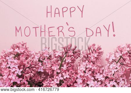 Spring Background Pink Color, Lilac Flowers Inscription Happy Mothers Day.