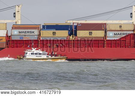 Rotterdam, Netherlands - 2021-04-07: Pilot Boarding A Merchant Ship To Guide It Into The Port Of Rot