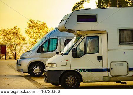 Camper Cars Recreational Vehicle Parking On Roadside. Holidays And Travel In Motor Home.