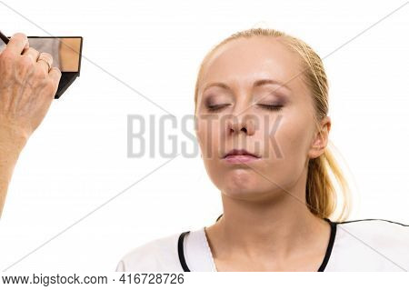 Two Women, Face Painting. Makeup Artist Applying Make Up To Model Face. Cosmetic Beauty Procedures,