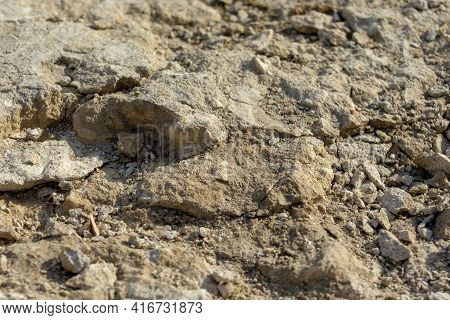 Dry Clay Soil Background With Soft Defocus For Background
