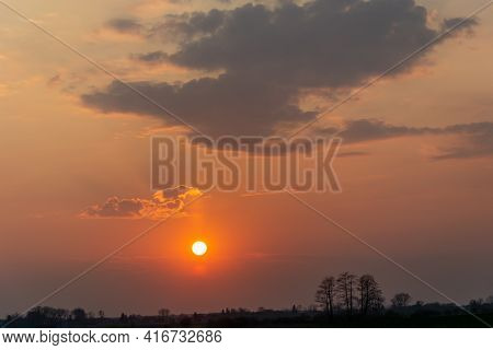 Round Sun And Hazy Pink Sky With Clouds, Sunset View