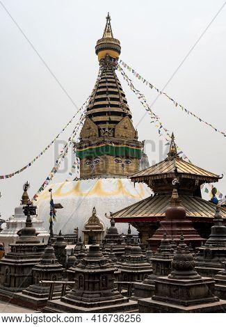 Kathmandu, Nepal - April 13, 2021: A Buddhist Temple On A Hill Overlooking The City Of Kathmandu, Ne
