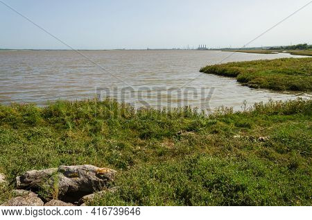 High Tide At Flint Foreshore On The River Dee In North Wales With Salt Marsh In The Foreground