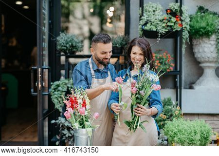 Seller Creating Fresh New Bouquet For Birthday, Festal, Anniversary Or Date At Workplace