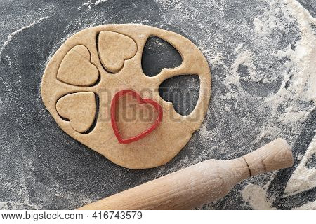Piece Of Dough And Cookie-cutters. Process Of Making Heart-shaped Shortbread Cookies